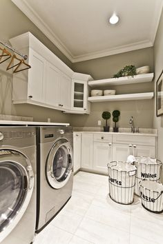 Lottery Home 2011 - the Mackenzie - contemporary - laundry room - edmonton - Marcson Homes Ltd. - folding table on top of machines - hanging  and baskets