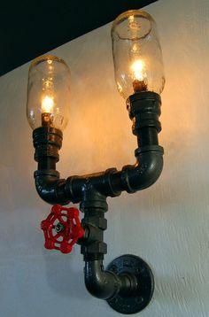 Industrial Wall Sconce, plumbing pipe repurposed industrial lighting, steam punk lamp. $185.00, via Etsy.