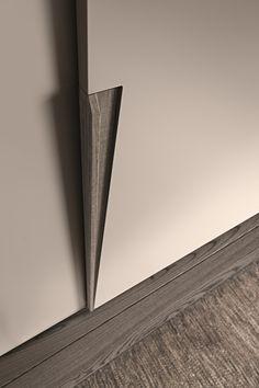 "Wardrobe with Jive sliding doors in matt grigio polvere lacquer with ""aged"" basalto oak handles."