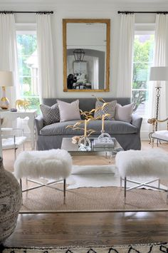 The gold accents add warmth to the cool grey tones in the living room ... Mix silver with gold. Side table only on one side of sofa w/lamp, and tall standing lamp on the other side.