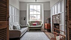 East London's most beautiful flat | Home | The Sunday Times Black Wainscoting, Wainscoting Nursery, Painted Wainscoting, Dining Room Wainscoting, Wainscoting Styles, Couple Room, Barcelona, Front Rooms, Brick Fireplace