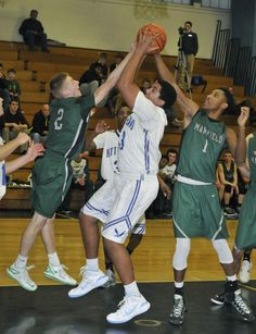 H.S. BOYS' BASKETBALL: Mansfield wins share of Kelley-Rex title