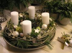 twig wreath, greenery, pinecones, stars, ornaments in a silver tray