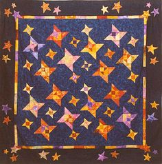 Ann Mitchell's Measure for Measure quilt based on the pattern in Cookies 'n' Quilts by Judy Martin. She changed the borders.