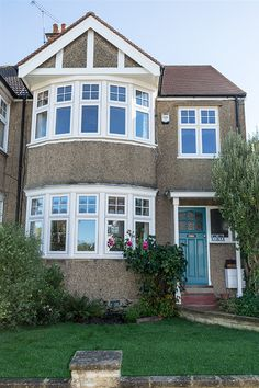 Enfield Windows - Our blog posts 1930s House Exterior, White Exterior Houses, Front Doors With Windows, House Windows, Enfield House, Bay Window Exterior, Pebble Dash, Porch Uk, Conservatory Ideas