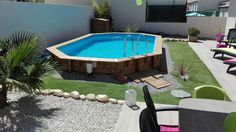 (General garden decoration) (Herault landscaping of the garden with semi buried wood pool by