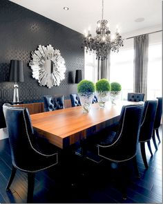 Chic dining room // Chrome, gator upholstery, nailheads, chandelier