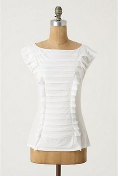 Make this with 2 recycled t-shirts:  http://jaynsarah.blogspot.com/2011/03/anthropologie-squeezebox-top-diy.html