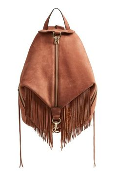 leather and fringe zip up back pack.