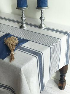French country style linen tablecloth with blue/grey ticking stripes. The base is a natural light taupe. Adorable rustic texture that is at the same time incredibly soft and pleasant both to eye as well as touch. Choose between blue, red or black stripes. High quality, premium 100%