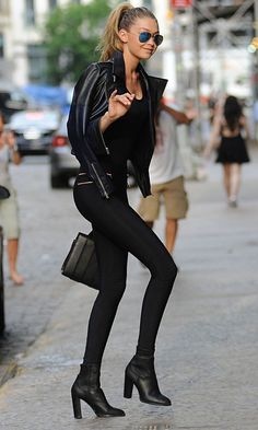 Pair a black leather biker jacket with black leggings for a lazy day look. Why not introduce black leather booties to the mix for an added touch of style?   Shop this look on Lookastic: https://lookastic.com/women/looks/biker-jacket-crew-neck-t-shirt-leggings/17706   — Blue Sunglasses  — Black Leather Biker Jacket  — Black Crew-neck T-shirt  — Black Leggings  — Black Leather Handbag  — Black Leather Ankle Boots
