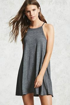 Style Deals - A semi-sheer, mini knit dress featuring a square neckline, sleeveless cut, cami straps, and a shift silhouette.
