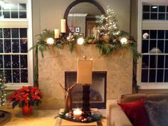 Use candles and small trees to add height to your mantle. Don't forget layering fresh greens and pine cones.