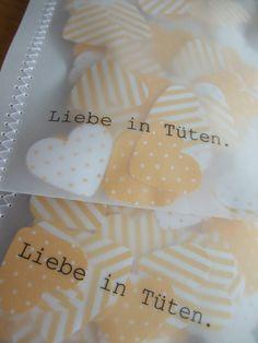 """Heart confetti. Sewn in a small paper bag.  Quote: """"Love in bags"""". www.facebook.com/daspapierlabor www.daspapierlabor.de"""