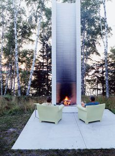 Super Tall and Mod: This extremely tall, white brick fireplace certainly makes a statement, and perhaps the structure of the fireplace keeps the smoke from blowing in your face. The view of the river isn't completely obstructed, because the chairs are angled out to the sides.    Source