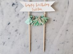 Cake topper with a banner to put your own text, making it suitable for any occasion /  Custom hand lettered in metallic gold, silver or rose gold calligraphy (you choose!) /  Each banner is individually hand-lettered and drawn (ask to include little drawings too if that fancies you) /  You can choose whatever text or design you like (send me inspo snaps), Ill draw it up for you /  200 gsm ivory cardstock banner /  5 baby tassels hung on twine, 5cm in height each, you can choose your own…