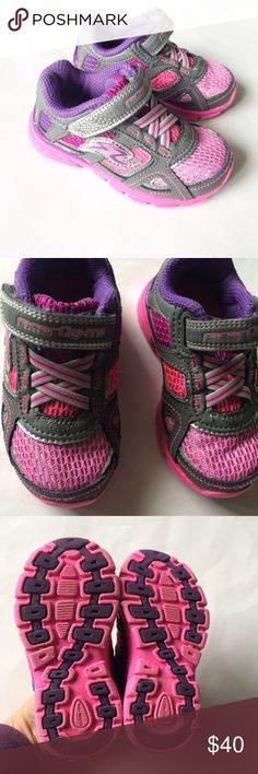 STRIDE RITE [baby girl] Pink Racer Lights Sneakers These sneakers are in really nice condition. A little bit of dirt on bottoms. Velcro closure. Racer lights light up on bottom when walking. Pink, purple and silver colors. Size 6 Wide. Stride Rite Shoes Sneakers