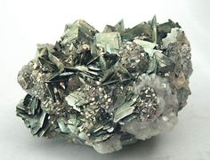 Marcasite (a sulfide mineral sometimes called white iron pyrite) with Pyrite, Arsenopyrite, Calcite and Dolomite. Marcasite and Pyrite are polymorphs. They have the same mineral composition but different crystal structures. Pyrite has a cubic structure and is hard enough to be used in jewelry, while Marcasite has an unstable orthorhombic crystal structure and is liable to break apart.