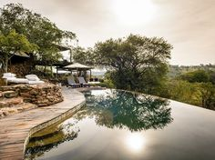 """""""Within Singita Grumeti's pristine 350,000-acre concession adjoining the Serengeti National Park, you might not see another vehicle for half a day. And that is precisely the point. Whether from high on the Sasakwa Hill at the lavish Sasakwa Lodge (from about $1,425 per person per night) with a gin and tonic in your hand or on the Grumeti river at the Faru-Faru Lodge (from about $1,150 per person per night), the animals just seem shinier, more abundant than in other parts of the…"""
