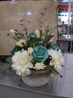 I love this teal, stone and touch of purples in this vase! Sherrie NJ Michaels
