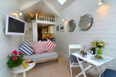 "Shaldon Beach Hut is a cute compact ""cabin."" Good idea for a guest house or micro house. Love the real stairs to loft instead of ladder! Beach Hut Interior, Nautical Interior, Tiny Living, Home And Living, Coastal Living, Bungalow, Summer House Interiors, Tyni House, Tiny Spaces"