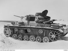 WESTERN DESERT, EGYPT. 1942-08. A GERMAN PANZERKAMPFWAGEN III L MEDIUM TANK KNOCKED OUT BY AUSTRALIAN ANTI-TANK GUNNERS NEAR EL ALAMEIN. A SMALL HOLE SLIGHTLY ABOVE AND BETWEEN THE 2ND AND 3RD ...