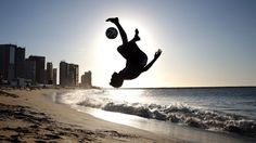 Amazing bicycle kick shot on what I expect is Copacabana beach in Rio de Janeiro!