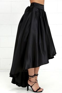 With the elegant silhouette of the Modern Mystery Black Satin High-Low Skirt, you are destined to make an grand entrance! Jaw-dropping poly satin creates a banded waist (with attached tying sash), and a pleated high-low skirt with a layer of tulle for volume. Hidden back zipper with clasp.