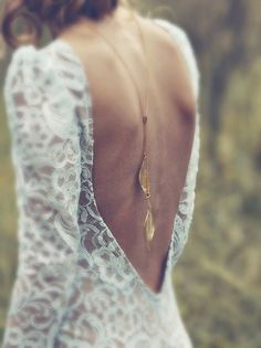 29 Back Wedding Necklaces – The Hottest Trend Right Now: #5. Thin boho back necklace with leaf charms