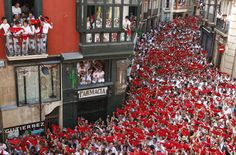 Revelers hold up their red scarves during the start of the San Fermin Festival in Pamplona, Spain. Description from shineyourlight-shineyourlight.blogspot.com. I searched for this on bing.com/images