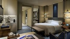 Four Seasons Seoul - Deluxe Room. Love the idea of stacked shelving bedside instead of a standard bedside table.