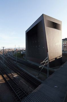 Signal Box by Herzog & de Meuron, Basel, Switzerland.  With an exterior cladding of copper strips that are twisted at certain places to admit daylight, the building acts as a Faraday cage protecting the electronic equipment inside from unexpected external effects.