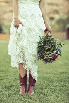 Lace gown with cowboy boots and a wildflower bouquet...perfect! From http://stylemepretty.com/gallery/picture/869510  Photo Credit: http://photographsbyanjuli.com/