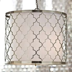 The Moroccan-style pattern in brushed silver is absolutely enchanting on this drum shade.