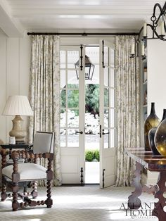 In the family room, French doors lead to the motor court.