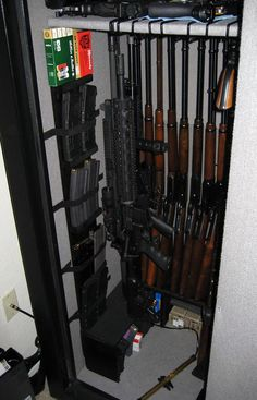 Nice customized gun safe.  Rifle Rods storing long guns and AR's, raised up on benches to store ammo underneath.  Great magazine racks.