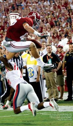 Richard Mullaney leaps over Ole Miss defender. | from the Tuscaloosa Magazine…