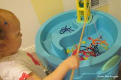 Tot School with Abby: All About Fine Motor.  Fishing for pipe cleaner fish!