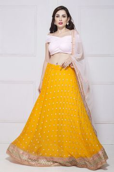 Pastel pink off shoulder blouse with yellow lehenga and pink net dupatta