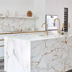 A marble kitchen island can make your cooking space feel luxe or simple and well-designed. Here are our favorite ways to incorporate the the ever-popular marble kitchen island. Luxury Kitchen Design, Kitchen Room Design, Luxury Kitchens, Home Decor Kitchen, Interior Design Kitchen, Kitchen Furniture, Home Kitchens, Marble Interior, Modern Kitchen Interiors