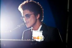 Bruno Mars is my favorite!! He is 5'5 and was born in Hawaii. He has 5 brothers and sisters. His real name is Peter Gene Hernandez. This is from when I was your man