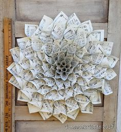 Perfect for the music lover on your list or for a first (paper) anniversary gift. This beautiful dahlia-style handmade rolled sheet music medallion wreath is crafted from reprinted vintage Christmas sheet music on ivory parchment paper. Rolled Paper Wreath, Paper Wreaths, Diy Gifts Paper, Paper Craft, Sheet Music Crafts, Table Topper Patterns, Christmas Sheet Music, Book Page Wreath, Magazine Crafts