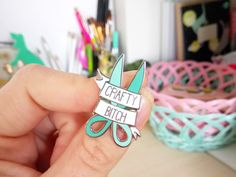 Cute Crafty Bitch hard Enamel Pin! Hand up if youre a CRAFTY BITCH🙋 I sure am! No crafty bitch could survive without her (or his) trusty scissors! This cute little pin is a pretty mint color & because its hard enamel is nice and shiny! Like all product in my etsy this pin is an original design. I work with a local (Dutch) manufacturer who helps to produce these lovely pins. - Measurements are (width x height) 2 x 3 cm - Has a Metal claps - Come on a card backing. - Made from the high qua...