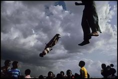 South Africa, 1992 - Soweto children soar on a trampoline.