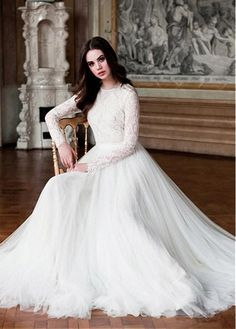 Buy discount Elegant Tulle & Lace Jewel Neckline A-Line Wedding Dresses With Long Sleeves at Laurenbridal.com