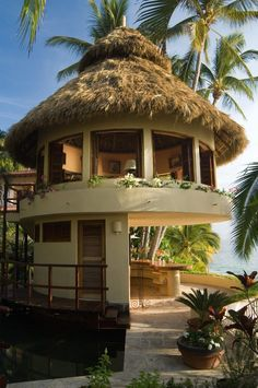 tropical vacation house exterior with wood railing interior and closet doors