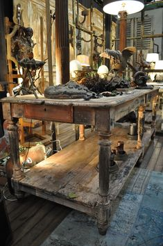 Old draper's table--I want it! Would make a great kitchen island.