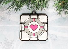 This cube from Portal | Community Post: 45 Awesome Christmas Ornaments Every Video Game Lover Needs