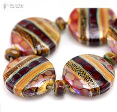 BeadsBot Blog | Glass Lampwork Beads, Art Components, Natural Cosmetics in Vintage Wrappings: November 2010