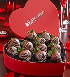 What's the fastest way to their heart? Chocolate-covered strawberries of course! This romantic heart-shaped box is filled with 12 large, juicy and undeniably tempting strawberries, hand-dipped and decorated in milk chocolaty delights and white chocolaty drizzle.